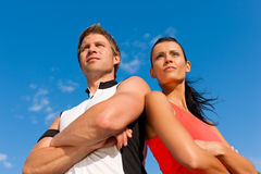 Young couple is doing sports outdoors Stock Image