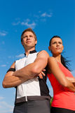 Young couple doing sports outdoors Stock Photos