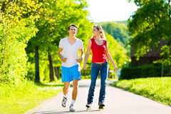 Young couple doing sports outdoors Stock Images