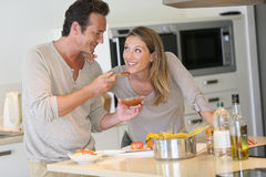 Young couple doing supper together royalty free stock image