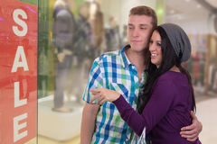 Young couple doing window shopping in a mall Stock Photos