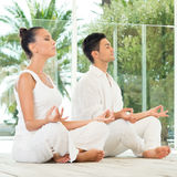 Young Couple Doing Yoga Royalty Free Stock Photo