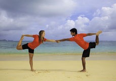 Young couple doing yoga, exercise Stock Image