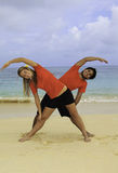 Young couple doing yoga, exercise Stock Images