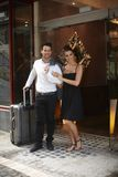 Young couple at doorway of hotel Stock Image