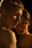 Young Couple - Dramatic image, on black Stock Image