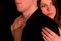 Young couple: dramatic portrait. On a black background Royalty Free Stock Images