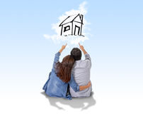 Young couple dreaming and imaging their new house in real state Royalty Free Stock Images