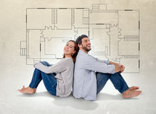 Young couple dreaming and imaging their new house in real state concept. Young attractive couple in love happy together thinking and imaging blueprints , floor Stock Photos