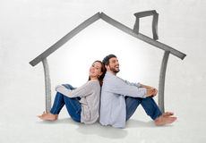 Young couple dreaming and imaging their new house in real state concept Stock Images