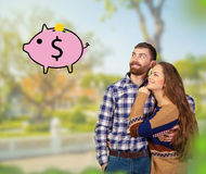 Young couple dreaming of money. Cheerful young couple dreaming of money Stock Images