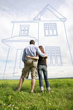 Young couple dreaming of new home. Stock Images