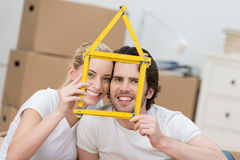 Young couple dreaming of their new home Stock Photography