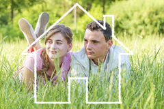 Young couple dreaming to a house Stock Image