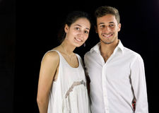 Young couple dressed in white ready for a party Royalty Free Stock Photo