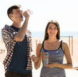 Young couple drink water Royalty Free Stock Image