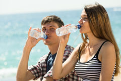 Young couple drink water Royalty Free Stock Photo