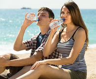 Young couple drink water Royalty Free Stock Photography