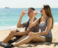 Young couple drink water Royalty Free Stock Images