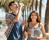 Young couple drink water Stock Images