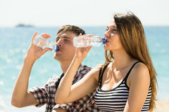 Young couple drink water Stock Photo