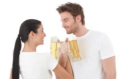 Young couple drinking beer smiling Stock Image