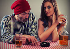 Young couple drinking beer and whiskey Stock Photo