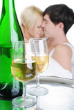 Young couple drinking champagne in bed Stock Image