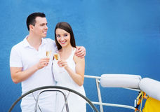 A young couple drinking champagne on a boat Royalty Free Stock Photography