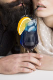 Young couple drinking cocktail Royalty Free Stock Photos