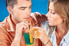 Young couple drinking cocktail. Young couple outdoor drinking cocktail on summer evening Stock Photos