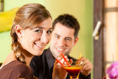 Young couple drinking cocktails Stock Photos