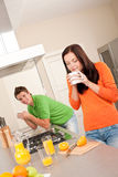 Young couple drinking coffe in the kitchen Royalty Free Stock Image