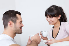 Young couple drinking coffee. Happy young couple drinking coffee at home Royalty Free Stock Photos