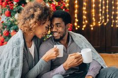 Free Young Couple Drinking Coffee At Christmas Tree Royalty Free Stock Photo - 160035695