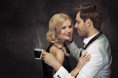 Young couple drinking coffee in the cafe Stock Images