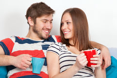 Young couple drinking coffee at home Stock Image