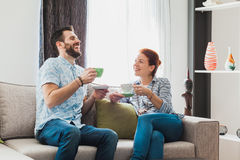 Young couple drinking coffee. In the living room Royalty Free Stock Images