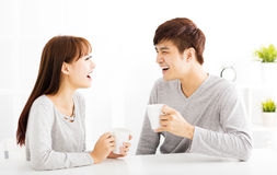 Young Couple drinking coffee In living room. Happy young Couple drinking coffee In living room stock images