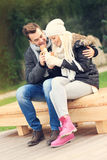 Young couple drinking coffee outdoors Royalty Free Stock Image