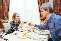 Young couple drinking and eating at the restaurant royalty free stock photo