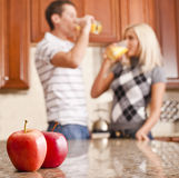 Young Couple Drinking Glass of Orange Juice Royalty Free Stock Photography