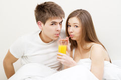 Young couple drinking juice Royalty Free Stock Images