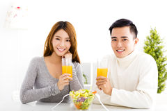 Young   couple drinking juice and healthy food Royalty Free Stock Photo