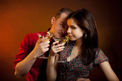 Young couple drinking martini Stock Photography