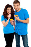 Young couple drinking orange juice together Royalty Free Stock Images
