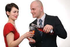 Young couple drinking red wine isolated. Stock Images