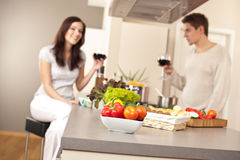 Young couple drinking red wine in kitchen Royalty Free Stock Image