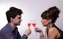 Young couple drinking rose wine Stock Images