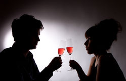 Young couple drinking rose wine Royalty Free Stock Photos